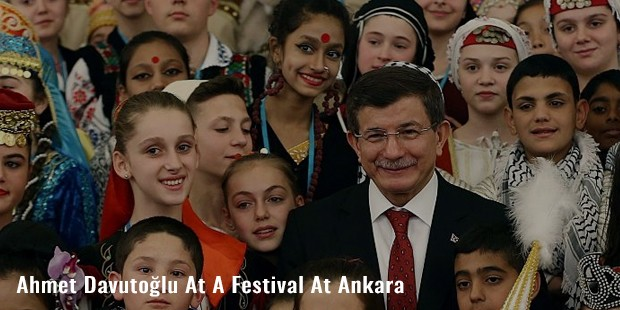 ahmet davutolu at a festival at ankara