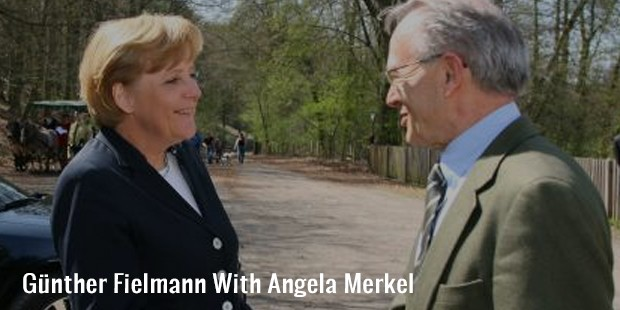 günther fielmann with angela merkel