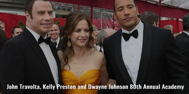 john travolta, kelly preston and dwayne johnson 80th annual academy