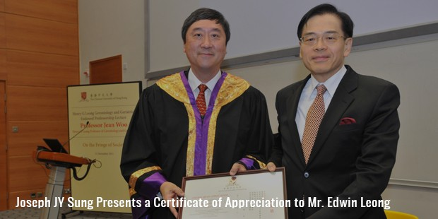joseph jy sung presents a certificate of appreciation to mr