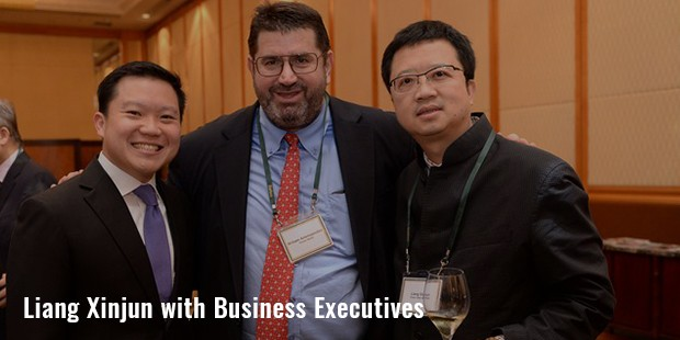 liang xinjun with business executives