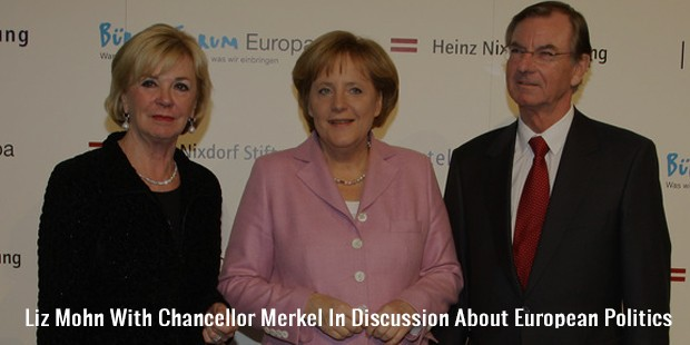liz mohn with chancellor merkel in discussion about european politics