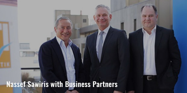 nassef sawiris with business partners