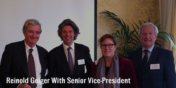 reinold geiger with senior vice president