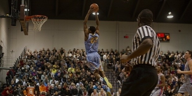 andrew wiggins rising high for a dunk at mcmaster university in hamilton