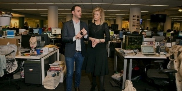 arianna huffington in the huffington post s newsroom with her editorial director, danny shea