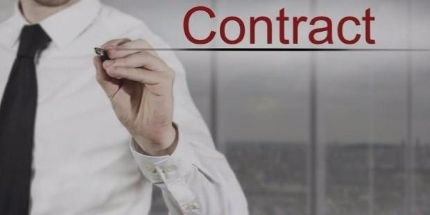 bigstock businessman writing contract i 73839349