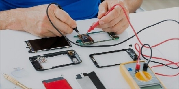 bigstock man repairing cellphone 80316401 830x554
