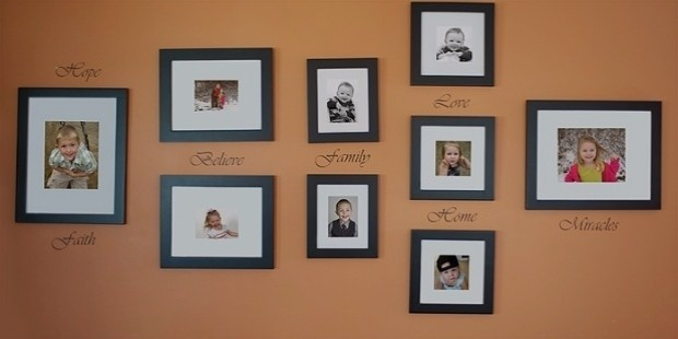 group of arranged photos hung on a large wall