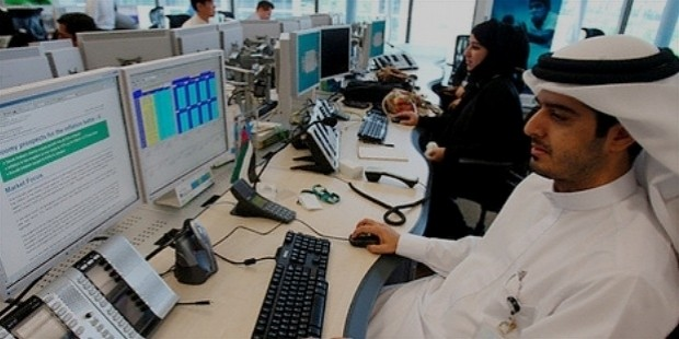 international employees of standard chartered work at the new trading room in dubai international financial centre