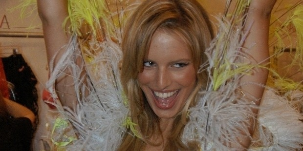 karolina kurkova celebrated in her feathered getup while backstage in 2002