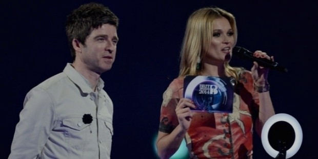 kate moss and noel gallagher onstage at the brit awards