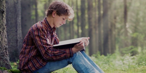 o teen boy reading book facebook 1056x528