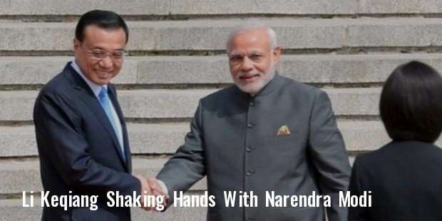 prime minister narendra modi and chinese premier li keqiang  l  shake hands