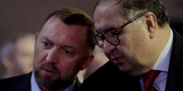 rusal, left, speaks with russian billionaire alisher usmanov, before the opening keynote speech on the first day of the world economic forum