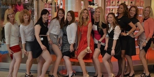 spanx founder sara blakely, center in red, with the staff of the new tampa