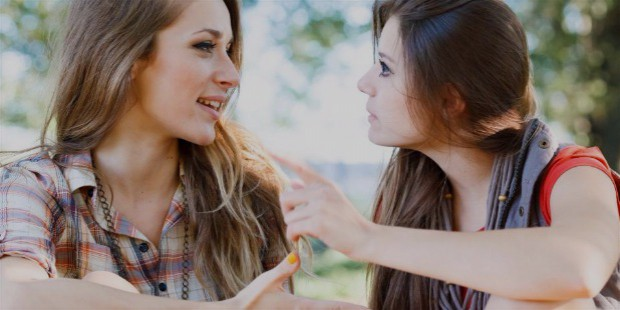 two young females talking to each other
