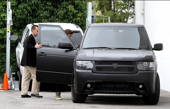 Justin Getting into His Black Range Rover