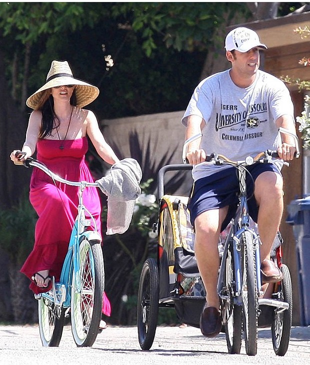 Adam and his wife riding on their bicycles