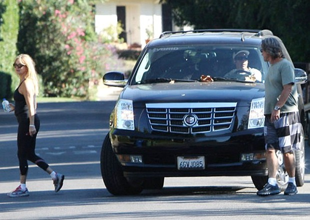 Adam driving his Cadillac
