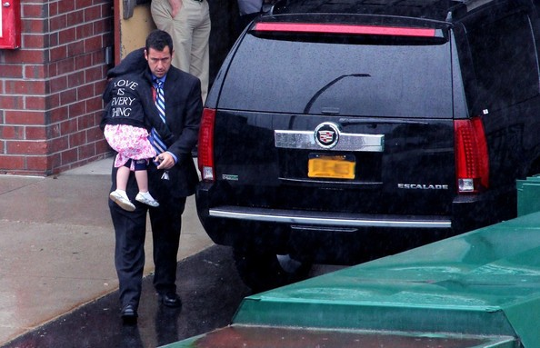 Adam with his daughter at his car