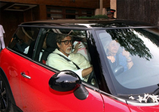 Big B driving his BMW Mini Cooper