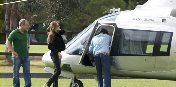 Angelina geetting into her helicopter