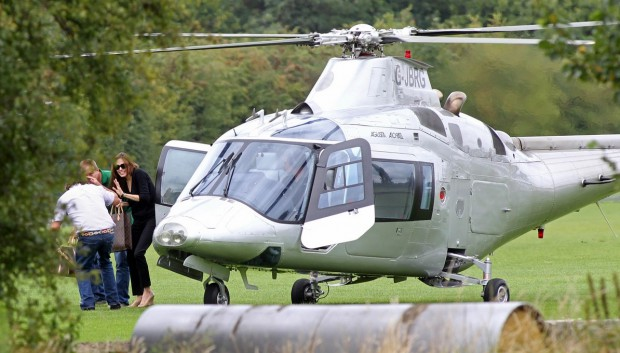 Angelina steps out from her helicopter
