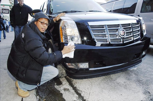 Terrence Howard With his Cadillac Escalade