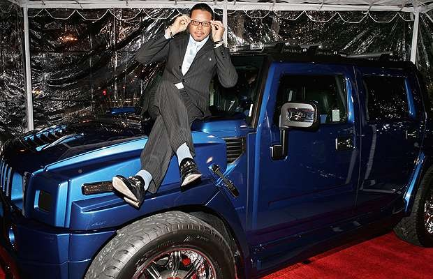 Actor Terrence Howard sits on a new Hummer H2