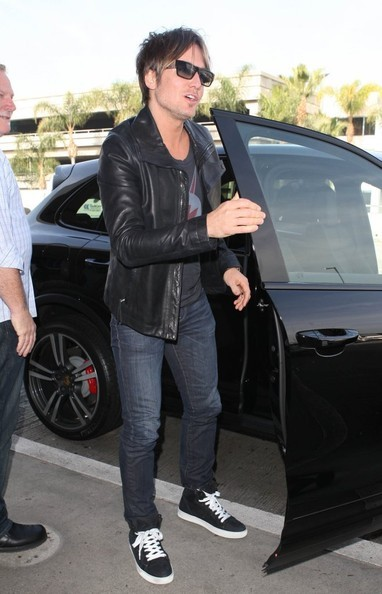 Keith Urban Getting Out from His Porsche