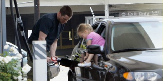 Christian Bale Filling Fuel into His BMW 325i, Look What His Little Girl Doing