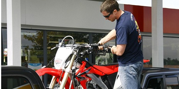 Christian Bale Filling His Fuel into His Bike