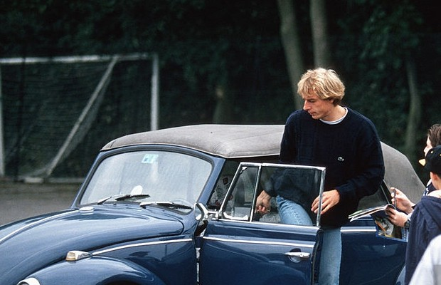 Jurgen into his classic Beetle car