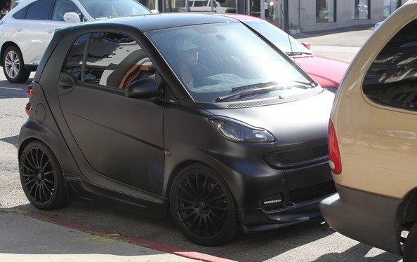 Justin in His Blacked-Out Smart Car