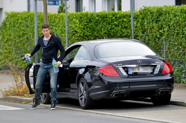 Robert Lewandowski with his Mercedes CL63 AMG