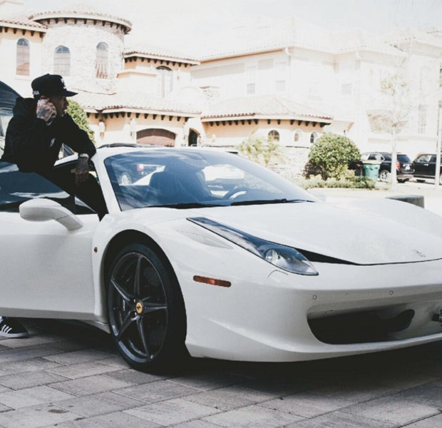 Tyga on his Ferrari