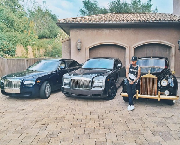 He Loves His Rolls Royce Isn't He ?