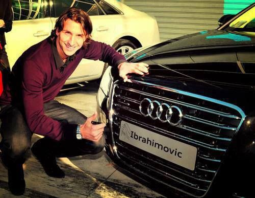 Zlatan signing his autograph on his Audi