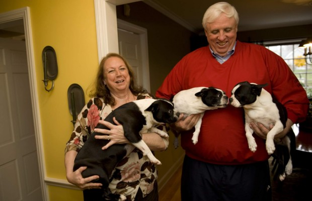 Jim and his wife cathy with pets at their house