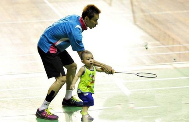 Lee Chong teaching His Son Kingston