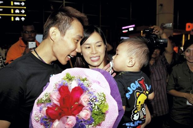 Lee Chong with His Wife and Son