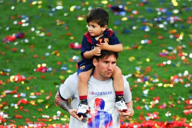 Thiago on shoulders of his dad Messi