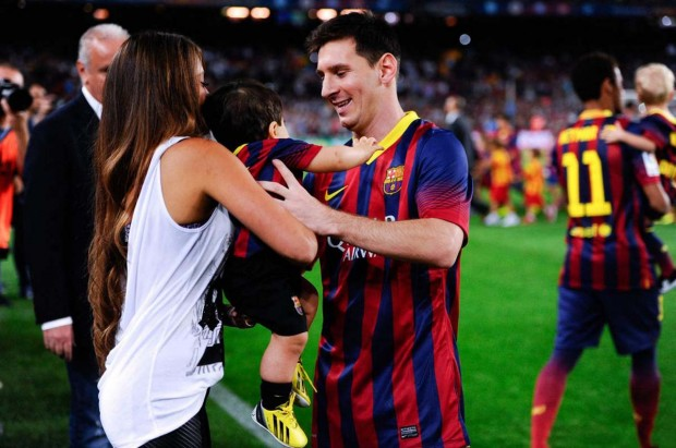 Messi with his partner Antonella Roccuzzo and son Thiago