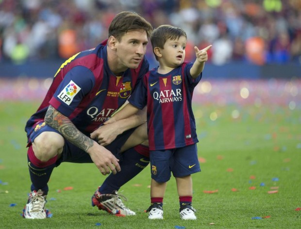 Thiago with his father Lionel Messi