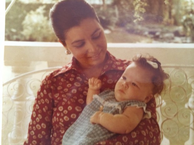 Baby Monique Lhuillier in the hands of her mother Amparito Llamas