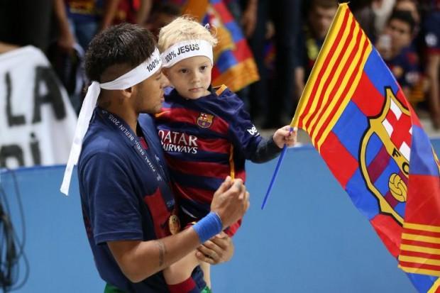 Neymar's son holding Barcelona Flag