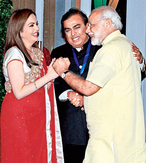 Prime Minister Narendra Modi is welcomed by Nita and Mukesh Ambani on his arrival for the re-dedication of the HN Reliance Foundation Hospital