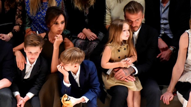 Victoria Beckham and her Family at Burberry Show
