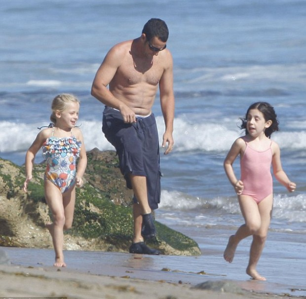 Adam Sandler with his daughter at beach